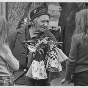 Woman selling dolls clothes in Chapel Market, Islington