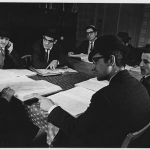 Jewish scholars around a table.