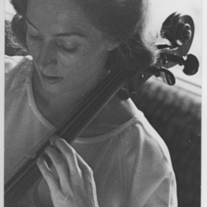 Amaryllis Fleming at her home in London playing the cello.